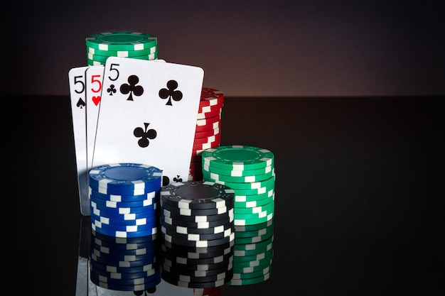 Poker cards with three kind or set combination. close-up of playing cards and chips in poker club. free advertising space