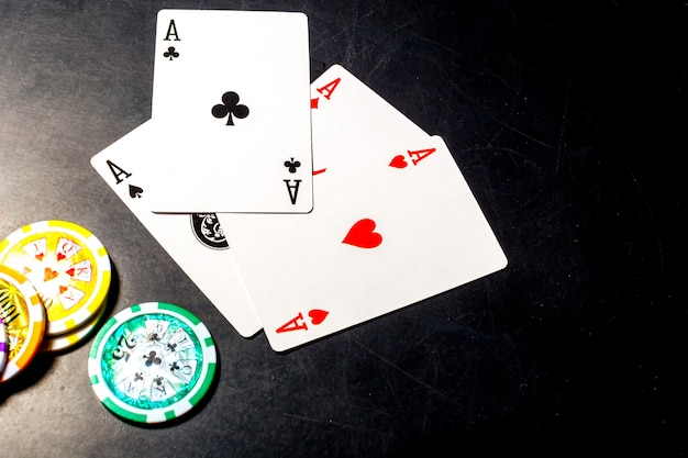 Poker chips and cards on black