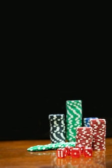 Poker chips in casino gamble wooden table.