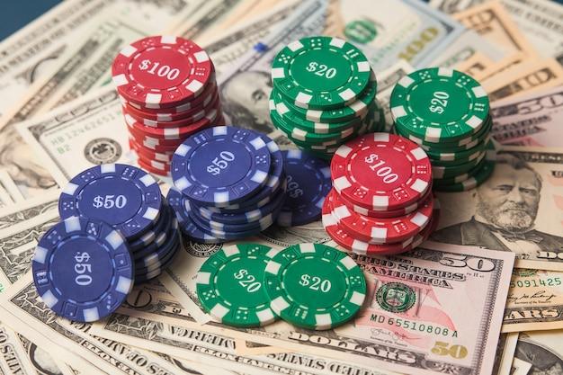 Poker chips on dollars