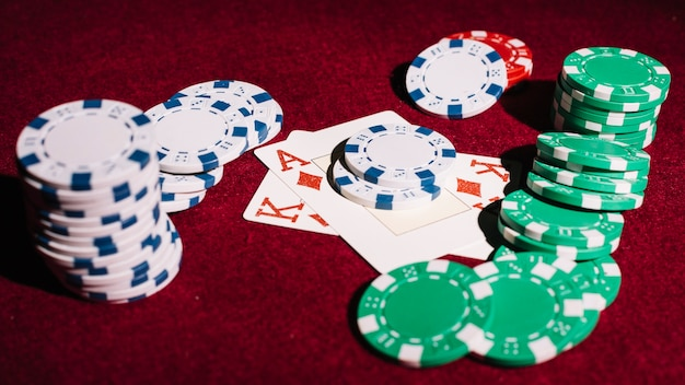 Poker chips and playing cards on table