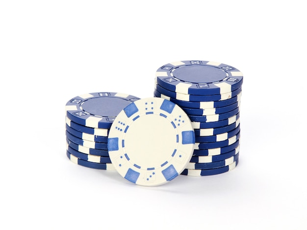 Poker chips stacked on each other isolated on a white background