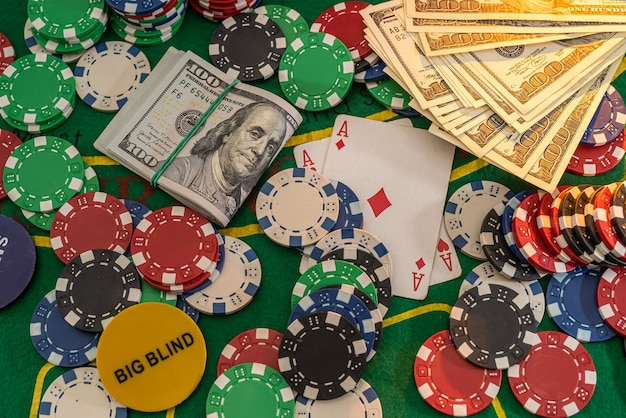 Poker combination with chips playing cards and win dollars in casino table. gambling