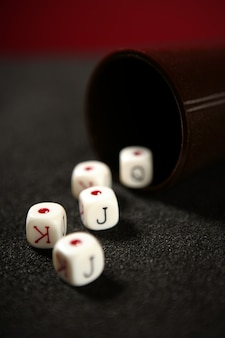 Poker game dices over black table
