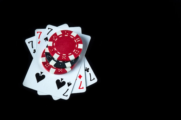 Poker game with a three of a kind or set combination. chips and cards on the black table in poker club. free advertising space