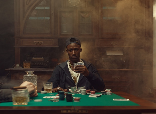 Poker player plays in casino. addiction