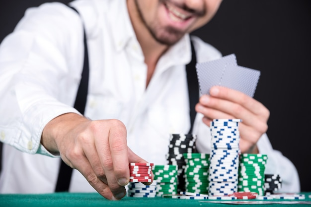 Poker player with poker chips.