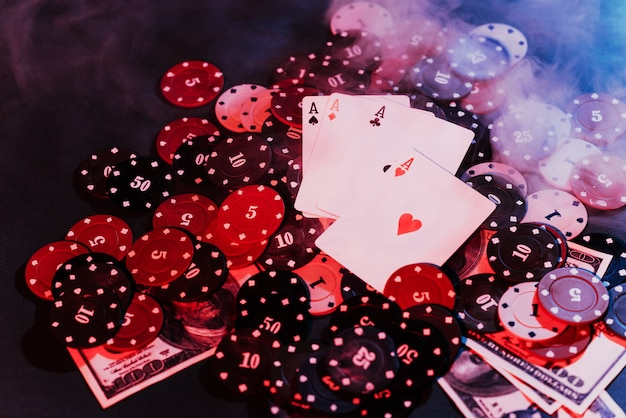 Poker playing chips, cards and money with puffed- up smoke. the view from the top