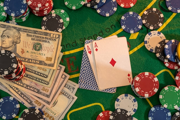 Poker playing chips with card and dollar banknoteson a casino green table. online gambling. texas