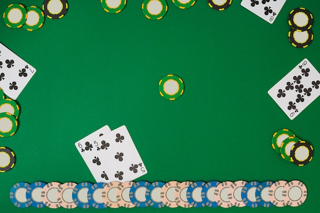 Poker. view from above with copy space. banner template layout mockup for online casino. green table, top view on workplace.