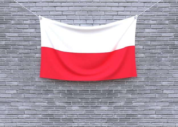 Poland flag hanging on brick wall