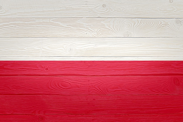 Poland flag painted on old wood plank background