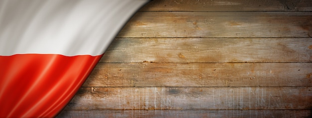 Poland flag on vintage wood wall. horizontal panoramic .