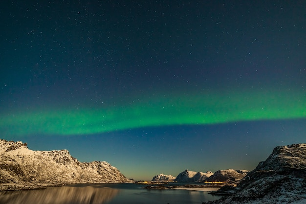 The polar arctic northern lights hunting aurora borealis sky star in norway travel photographer mountains