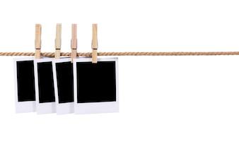 Polaroid photos on a rope