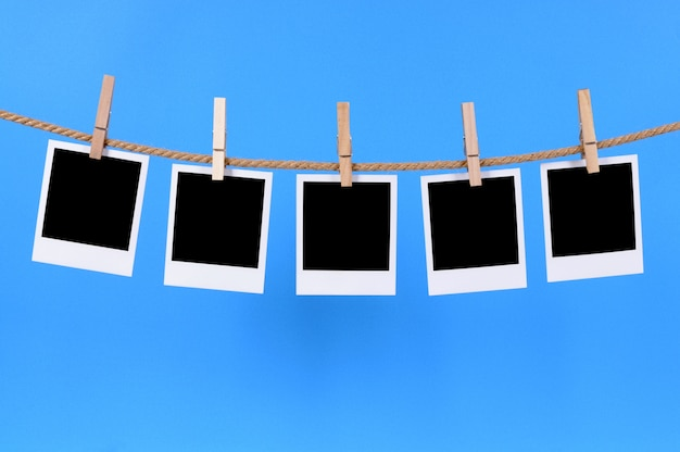 Polaroid photos on a string