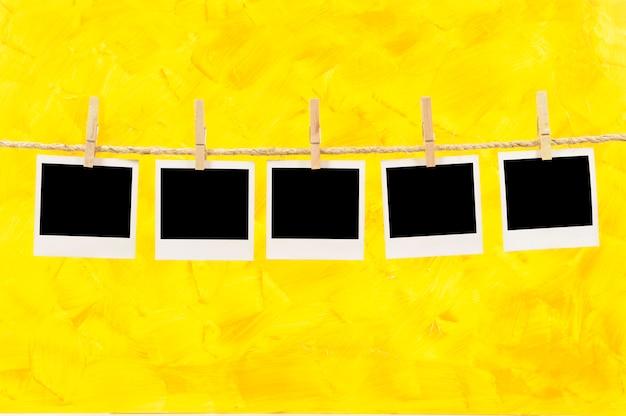Polaroid photos on a yellow background