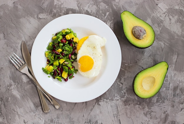 Polenta with fried eggs and avocado bean salsa