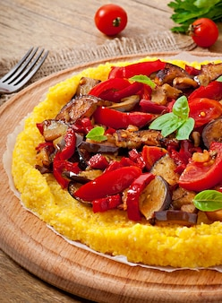 Polenta with vegetables - corn grits pizza with tomato and eggplant