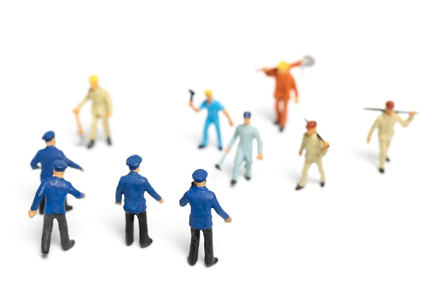 Police and an angry mob on white background Premium Photo