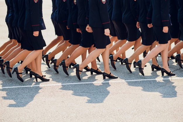 The police are marching. legs. shoes in line.