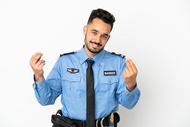 お金のジェスチャーを作る白い背景で隔離警察の白人男性