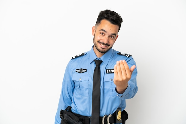 Police caucasian man isolated on white background inviting to come with hand. happy that you came