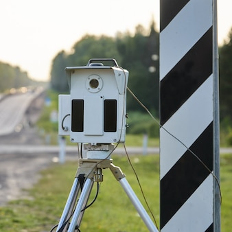 Police radar for measuring a speed of passing cars on highway in russia in summer day