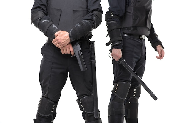 Полиция с ружьем и дубинкой на белом