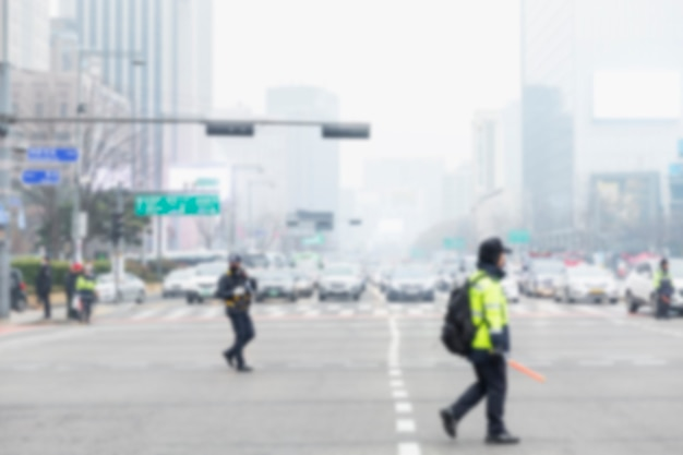 Policemen on the avenue of the big city. car traffic at the intersection. blurred.