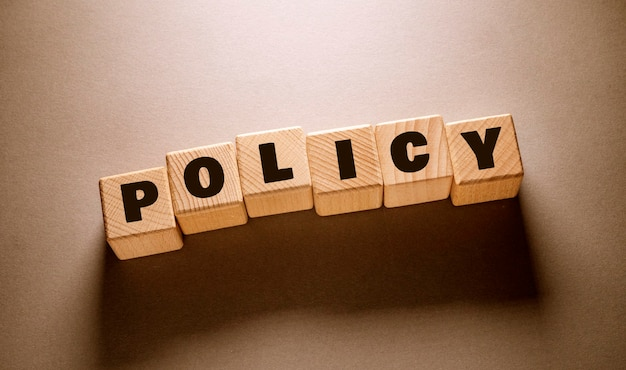 Policy word written on wooden cubes