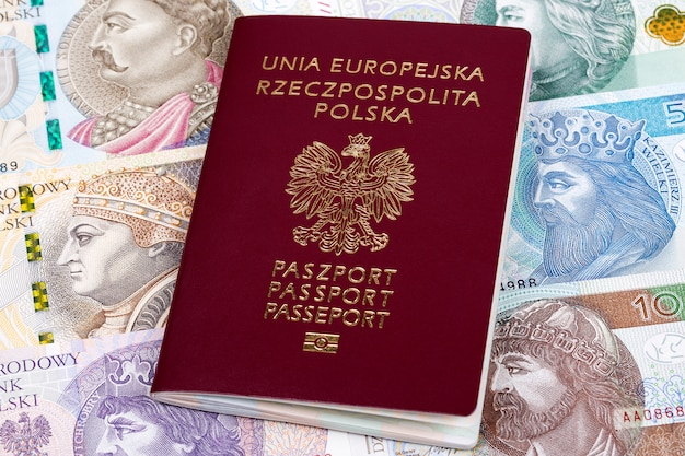 Polish passport on a background of banknotes