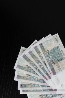 Polish zloty banknotes on a black background