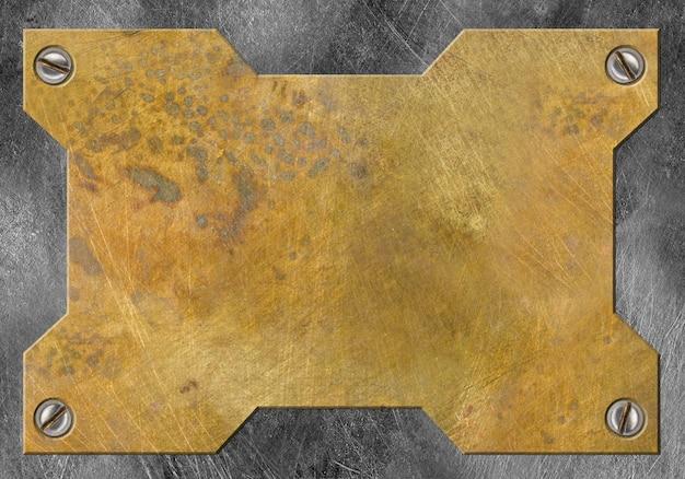 磨かれた真鍮の金属の背景