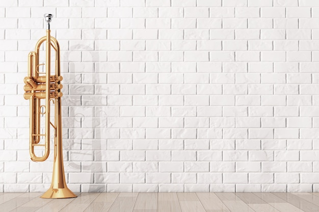 벽돌 벽 앞 광택 황동 트럼펫