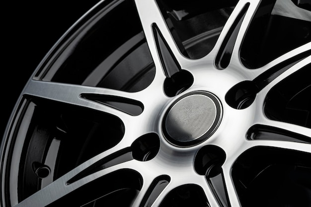 Polished spokes of a car alloy wheel, close-up on a black background.