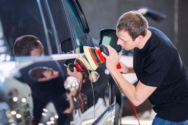 Polishing the car body.