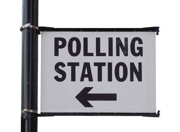 Polling station sign isolated over white