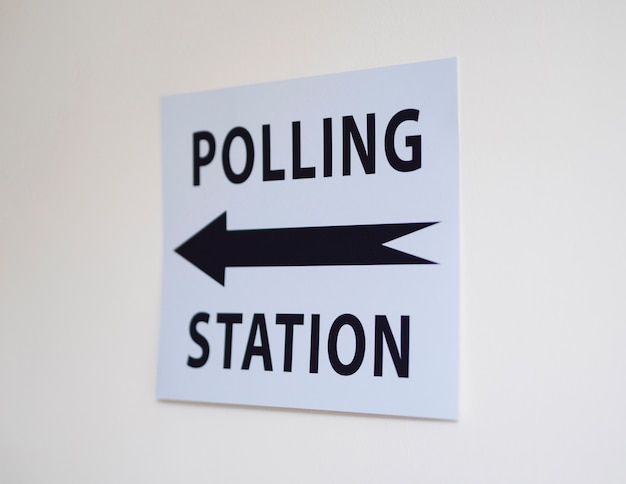 Polling station sign with direction