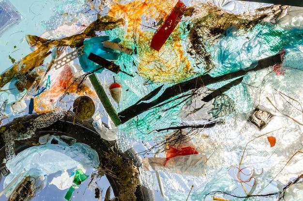 Pollution of ocean water plastic and debris float in water