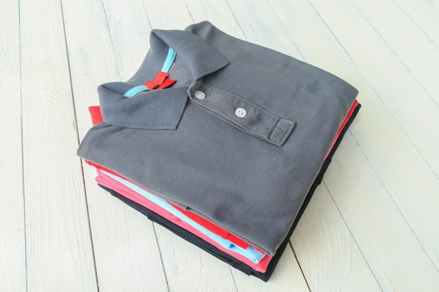 Polo shirts on wooden