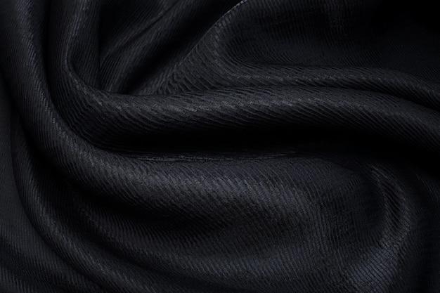 Ткань из полиамида и вискозы. черный цвет. текстура, фон, узор.