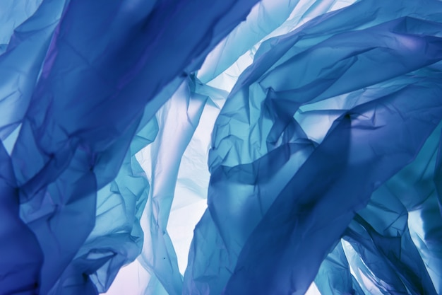 Polyethylene bag background. abstract blue illustration. use as wallpaper or for web design.