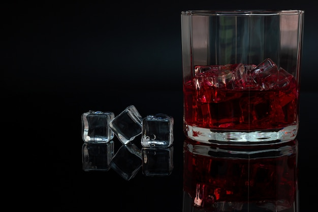 Polygon glass and reflection of liquor and ice