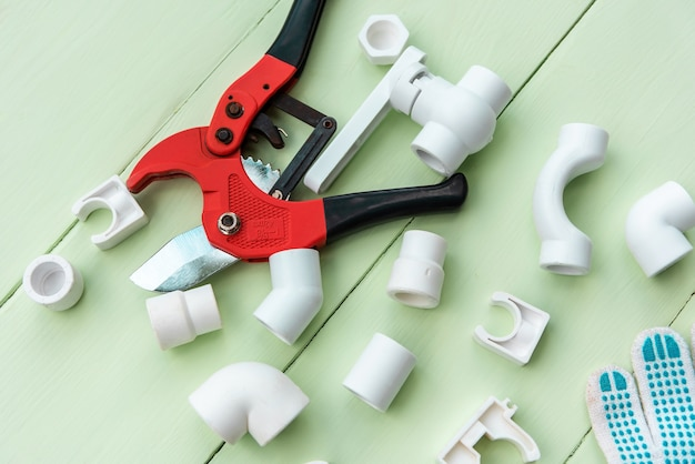 Polypropylene fittings and taps with pipe cutters.