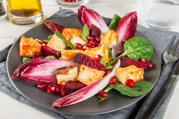 Pomegranate, beetroot, red chicory, spinach, mint and halloumi salad