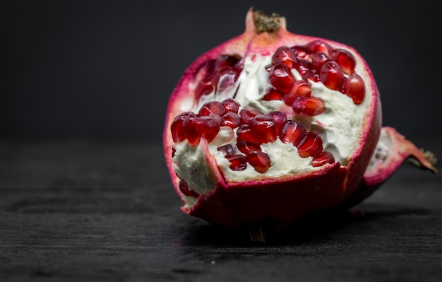 Pomegranate on a black background