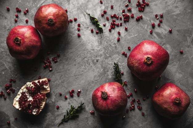 Pomegranate fruit. ripe and juicy pomegranate on rustic grey