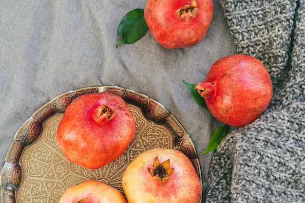 Pomegranate on a gray plaid close up