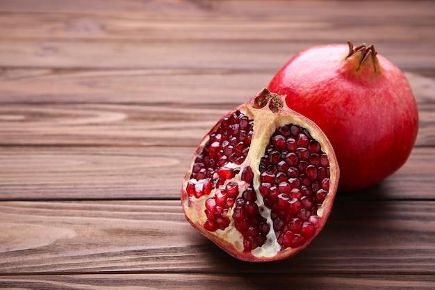 Pomegranate and half of ripe pomegranate